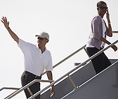 Honolulu, HI - January 1, 2009 -- United States President-elect Barack Obama (L) waves farewell as he and his wife Michelle (R) boards his chartered flight for Chicago Thursday, January 1, 2009 at Honolulu International Airport in Honolulu, Hawaii. Obama and his family arrived in his native Hawaii December 20 with his family for a low-key twelve day vacation. .Credit: Kent Nishimura - Pool via CNP
