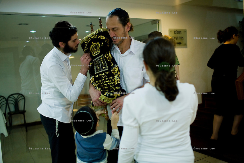 Community members and Rabbi Wilhelm's children kiss the Torah at Chabad Bangkok (Khao San road), Thailand for Chanuka celebrations on 12th December 2009..Photo by Suzanne Lee / For Chabad Lubavitch