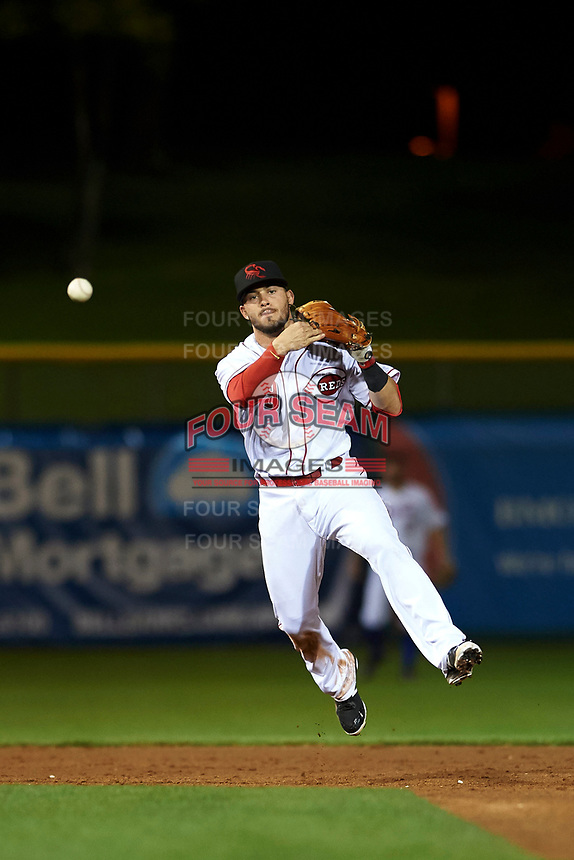 Scottsdale Scorpions shortstop shortstop Blake Trahan (9), of the Cincinnati Reds organization, makes a throw to first base during an Arizona Fall League game against the Peoria Javelinas on October 20, 2017 at Scottsdale Stadium in Scottsdale, Arizona. the Javelinas defeated the Scorpions 2-0. (Zachary Lucy/Four Seam Images)