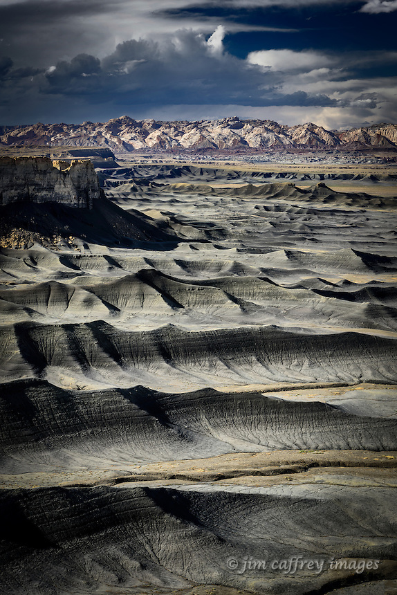 A series of erode ridges at the foot of Factory Bench near Caineville in central Utah appear to be waves advancing on a beach.