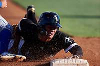 AZL White Sox Samil Polanco (13) slides into third base before being called out on the tag during an Arizona League game against the AZL Royals at Camelback Ranch on June 19, 2019 in Glendale, Arizona. AZL White Sox defeated AZL Royals 4-2. (Zachary Lucy/Four Seam Images)