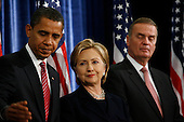 Chicago, IL - December 1, 2008 -- United States President-elect Barack Obama, left, United States Senator Hillary Rodham Clinton (DEmocrat of New York), middle, as his nominee for Secretary of State, and James L. Jones, right, chosen as national security adviser get ready to listen to defense secretary Robert Gates, who Obama says will remain in his post Monday morning, December 1, 2008 at the Chicago Hilton & Towers in Chicago, Illinois..Credit: Anne Ryan - Pool via CNP