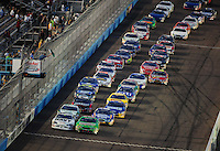 Apr 11, 2008; Avondale, AZ, USA; NASCAR Nationwide Series drivers Kyle Busch (18) and Brad Keselowski (88) lead the field to the green flag during the Bashas Supermarkets 200 at the Las Vegas Motor Speedway. Mandatory Credit: Mark J. Rebilas-