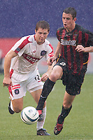 Mark Lisi of the MetroStars is marked by Logan Pause of the Fire during a rain shower. The Chicago Fire defeated the NY/NJ MetroStars 3-2 on 6/14/03 at Giant's Stadium, NJ..