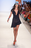 Model walks runway at Luli Fama Swimwear Show during Mercedes Benz IMG Fashion Swim Week 2014 at The Raleigh Hotel, Miami Beach, FL on July 21, 2013