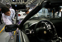 A Chinese worker puts the final touch on a MG car at the Nanjing MG Automibile Corporation plant before the vehicle's launch in Nanjing, China. The Chinese company is now in a position to take on Rover's assets and plan its future. It intended to relocate the engine plant and some car production plant to China but to retain some car production plant in the UK..27 Mar 2007