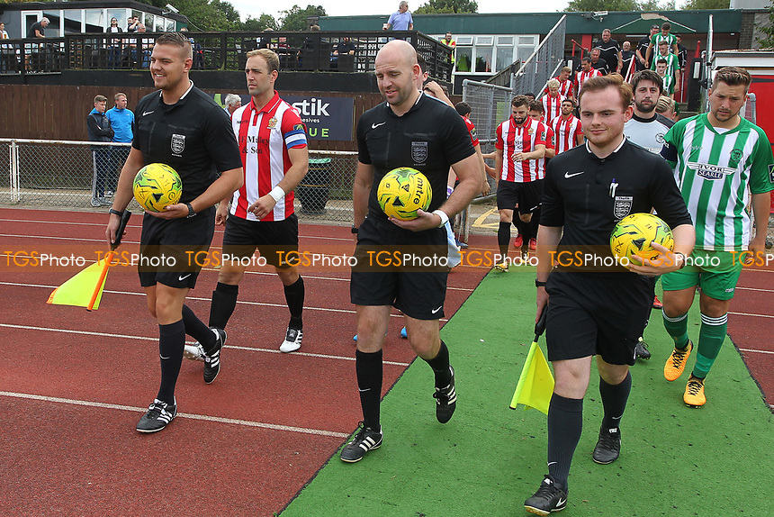 Teams make their way on to pitchy for the first game of the season during AFC Hornchurch vs Soham Town Rangers, Bostik League Division 1 North Football at Hornchurch Stadium on 12th August 2017