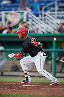 Batavia Muckdogs center fielder Ricardo Cespedes (32) follows through on a swing during a game against the West Virginia Black Bears on June 18, 2018 at Dwyer Stadium in Batavia, New York.  Batavia defeated West Virginia 9-6.  (Mike Janes/Four Seam Images)