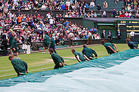 02-07-12, England, London, Tennis , Wimbledon,    Covers ore puled over center court when rain sets in.