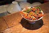 CANADA, Vancouver, British Columbia, a bowl of fried shrimp heads are served at a local bistro Edible Canada located on Granville Island