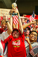 A fan holds up a replica of the World Cup trophy. The USA defeated Mexico 2-0 in the Round of 16 of the FIFA World Cup 2002 in South Korea on June 17, 2002.