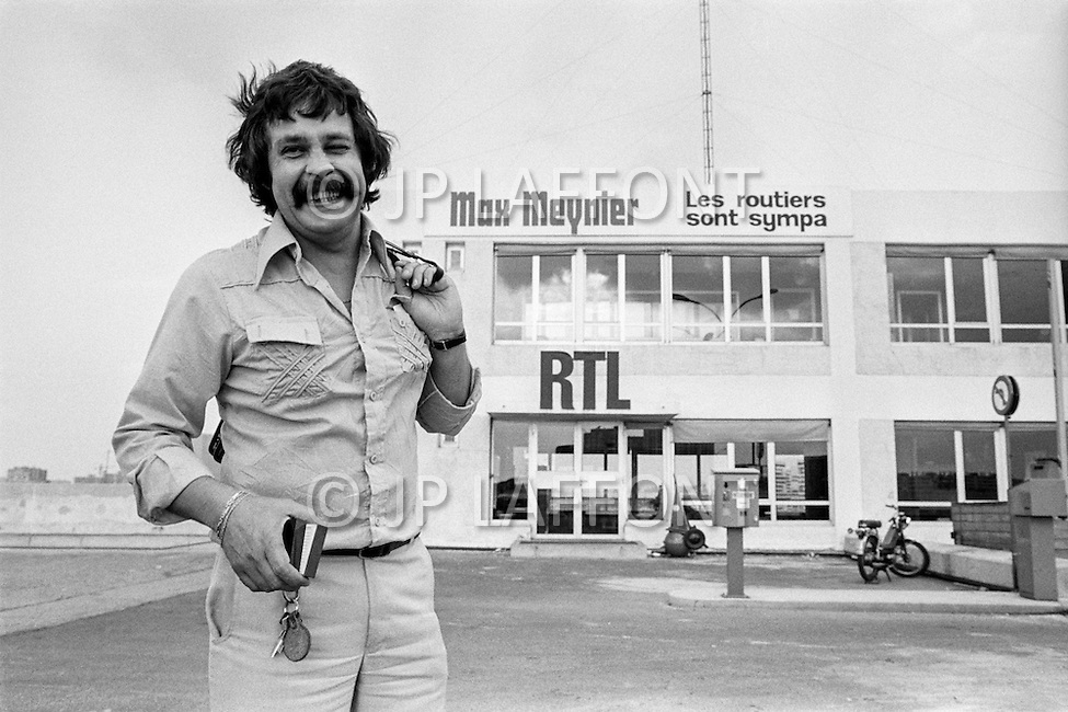 """11 Aug 1977, Paris, France --- French TV and radio presenter Max meynier, well known for his show """"Les routiers sont sympas"""", on RTL. --- Image by © JP Laffont"""