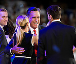 Republican presidential candidate Mitt Romney hugs his vice presidential nominee Paul Ryan and his wife Janna at the 2012 Republican National Convention at the Tampa Bay Times Forum in Tampa on August 30, 2012.