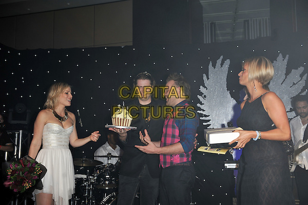 Natasha and Daniel Bedingfield.'Global Angels Awards', The Park Plaza Hotel, Westminster, London, England. 2nd December 2011..music on stage live concert gig performing half length microphone dress  strapless white cupcake cake .CAP/MAR.© Martin Harris/Capital Pictures.