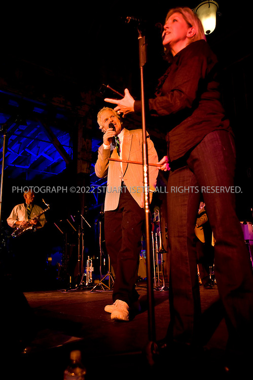 10/24/2008--Seattle, WA, USA..The Frustrations, a band of CEOs and executives from Washington State, play at a charity event to raise funds for Family Services. Here, LEFT TO RIGHT: Bruce Vanderwall ? Real Estate Developer, Lori Owens ? Owens Homes Inc....©2008 Stuart Isett. All rights reserved.