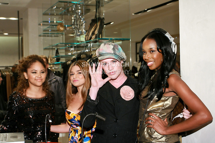 Richie Rich poses with DJ Kiss at the Elie Tahari Boutique opening at Saks Fifth Avenue, October 19, 2010.