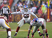 Landover, MD - November 30, 2008 -- New York Giants linebacker .Antonio Pierce (58) calls defensive signals as defensive end Justin Tuck (91) prepare to rush the passer against the Washington Redskins at FedEx Field in Landover, Maryland on Sunday, November 30, 2008. The Giants won the game 23 - 7..Credit: Ron Sachs / CNP.(RESTRICTION: No New York Metro or other Newspapers within a 75 mile radius of New York City)