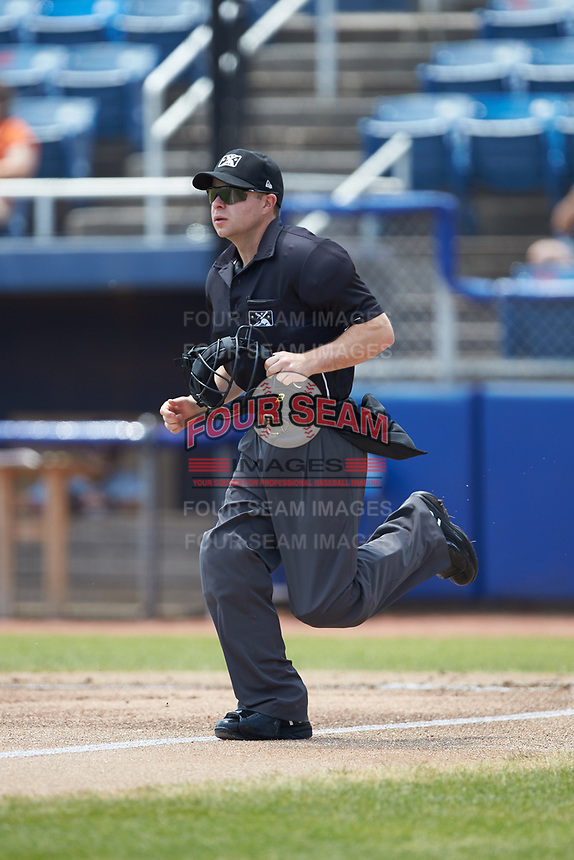 Home plate umpire John Budka hustles to get into position to make a call during the Carolina League game between the Winston-Salem Dash and the San Bernardos de Salem at Haley Toyota Field on June 30, 2019 in Salem, Virginia. The Dash defeated the San Bernardos 3-2. (Brian Westerholt/Four Seam Images)