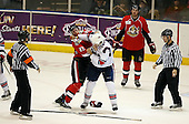 February 22nd 2008:  Matt Carkner (22) of the Binghamton Senators fights Anthony Stewart (24) of the Rochester Amerks as linesman Michael Baker, referee Jamie Koharski (84) and Shawn Weller (9) watch at Blue Cross Arena at the War Memorial in Rochester, NY.  The Senators defeated the Amerks 4-0.   Photo copyright Mike Janes Photography