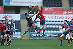 Ospreys centre Josh Matavesi and Munster wing Ronan O'Mahony compete for the high ball.<br /> Guiness Pro12<br /> Ospreys v Munster<br /> Liberty Stadium<br /> 07.03.15<br /> &copy;Steve Pope - SPORTINGWALES