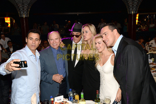 Adrian Paul, Merlin &quot;Chris&quot; Loken, , Robert Davi, Alexander Nevsky, Oksana Sidorenko, Kristanna Loken, Olga Rodionova<br /> &quot;Stars of the world - children of Russia&quot;, Charitable reception, Club Metelitsa, Moscow, Russia.<br /> July 2nd, 2013<br /> half length blue suit black dress father dad daughter family white shirt tie hat sunglasses shades blue posing taking picture photograph <br /> CAP/PER/AL<br /> &copy;AL/PersonaStars/CapitalPictures