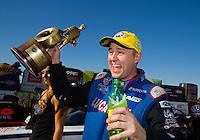 Oct 18, 2015; Ennis, TX, USA; NHRA top fuel driver Richie Crampton celebrates after winning the Fall Nationals at Texas Motorplex. Mandatory Credit: Mark J. Rebilas-USA TODAY Sports