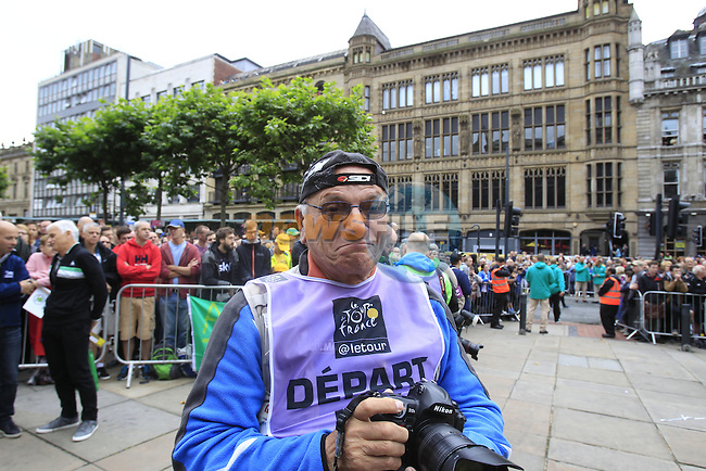 Photographer Silvano Ferrari at sign on before the start of Stage 1 of the 2014 Tour de France running 190.5km from Leeds to Harrogate. 5th July 2014.<br /> Picture: Eoin Clarke www.newsfile.ie