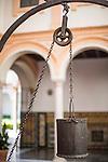 Ancient iron well bucket, Aljibe cloister, Museum of Fine Arts, Seville, Spain