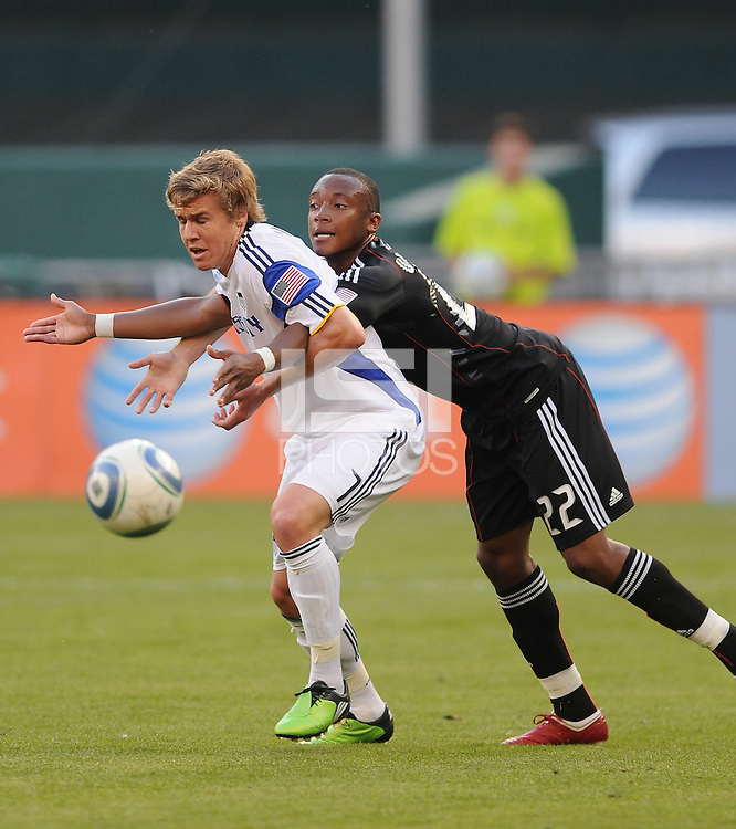 Kansas City Wizards midfielder Chance Myres gets foul by DC United defener Rodney Wallace (22).  DC United defeated The Kansas City Wizards  2-0 at RFK Stadium, Wednesday  May 5, 2010.