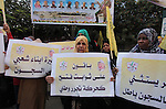 Palestinians who support Palestinian senior Fatah official Mohammed Dahlan, hold banners and national flags during a protest against Palestinian President Mahmoud Abbas in Gaza City on November 28, 2016. Photo by Ashraf Amra