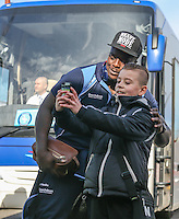 Adebayo Akinfenwa of Wycombe Wanderers poses for a photo with a young football fan as he arrives for the Sky Bet League 2 match between Grimsby Town and Wycombe Wanderers at Blundell Park, Cleethorpes, England on 4 March 2017. Photo by Andy Rowland / PRiME Media Images.