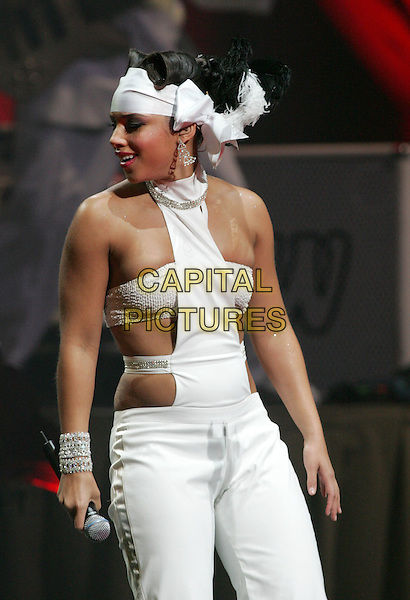 ALICIA KEYS.Performing to a sold out crowd at The Kodak Theatre in Hollywood, California..March 16th, 2005.half length white  cut out cut away headband  bracelet halterneck.www.capitalpictures.com.sales@capitalpictures.com.Supplied By Capital PIctures