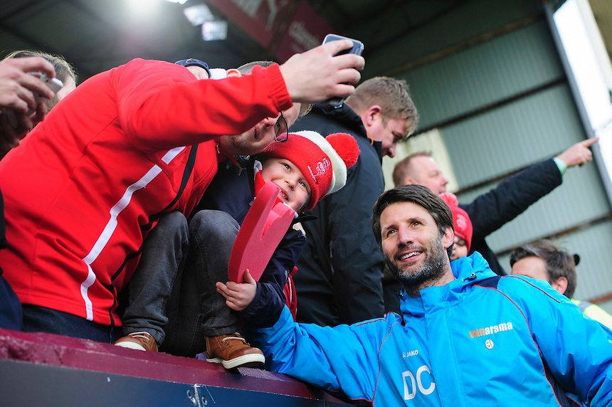 Lincoln City manager Danny Cowley poses for a selfie with Lincoln City fans at the end of the game<br /> <br /> Photographer Chris Vaughan/CameraSport<br /> <br /> Emirates FA Cup Fifth Round - Burnley v Lincoln City - Saturday 18th February 2017 - Turf Moor - Burnley <br />  <br /> World Copyright &copy; 2017 CameraSport. All rights reserved. 43 Linden Ave. Countesthorpe. Leicester. England. LE8 5PG - Tel: +44 (0) 116 277 4147 - admin@camerasport.com - www.camerasport.com