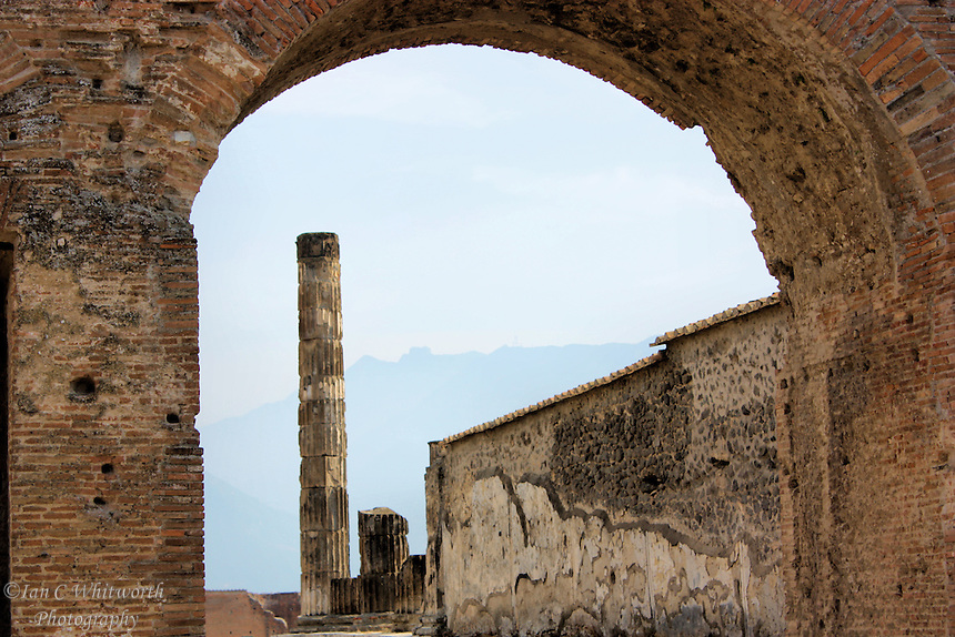 Looking through an archway at the ruins at Pompeii in Italy