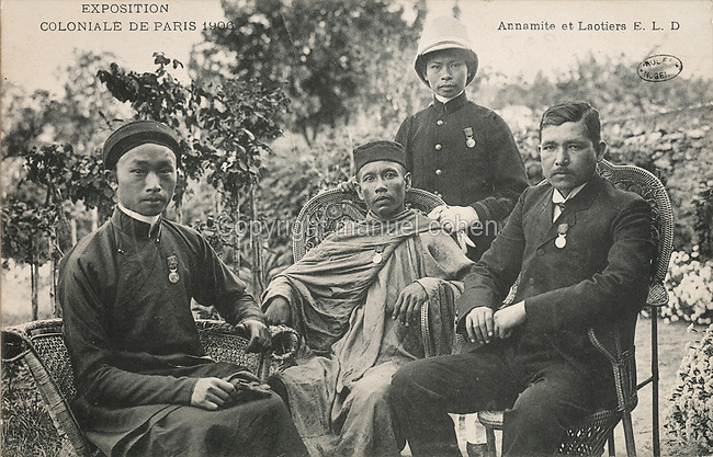 People from Annam (Vietnam) and Laos, at the Colonial Exhibition in Paris, July - November 1906, held at the Grand Palais on the Champs-Elysees, postcard from the Musee de Nogent sur Marne, Eastern Paris, France. Colonial Exhibitions were designed to increase trade with and investment in, French Overseas Territories. Picture by Manuel Cohen / Musee de Nogent sur Marne