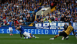 Leon Clarke of Sheffield Utd scores the second goal past Keiren Westwood of Sheffield Wednesday during the Championship match at the Hillsborough Stadium, Sheffield. Picture date 24th September 2017. Picture credit should read: Simon Bellis/Sportimage