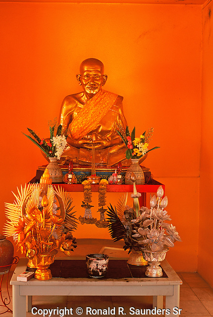 ALTAR WITH RELIGIOUS STATUE AND DECORATIONS