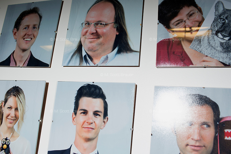 Photos of researchers and students in the Center for Civic Media at the MIT Media Lab in Cambridge, Massachusetts, USA. Director of the Center for Civic Media Ethan Zuckerman is visible at the center of the top row.