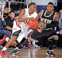 18 November 2010:  FIU's Jeremy Allen (32) defends FSU's Ian Miller (30) in the second half as the Florida State University Seminoles defeated the FIU Golden Panthers, 89-66, at the U.S. Century Bank Arena in Miami, Florida.