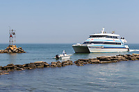 A Hy-Line Cruises high-speed ferry from Hyannis to Martha's Vineyard enters Oak Bluffs Harbor in Oak Bluffs, Massachusetts.