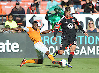 Conor Doyle (30) of D.C. United goes against Warren Creavalle (5) of the Houston Dynamo. The Houston Dynamo defeated D.C. United 2-1, at RFK Stadium, Saturday October 27, 2013.