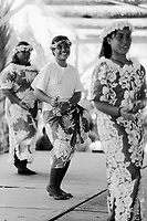 Republic of Nauru. Central Pacific. Nauru is a tiny island (21 square-km). Women sing and dance in a traditionnal way at the celebration of Kayser College's 50 years teaching to island's students. Kayser College is a catholic school. Pacific Islander women wearing lei on theirs heads © 1999 Didier Ruef ..