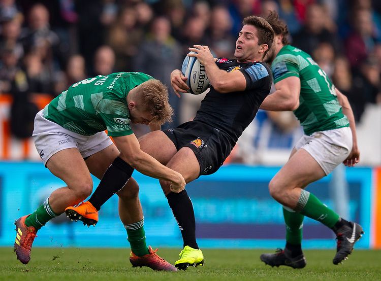 Exeter Chiefs' Santiago Cordero is tackled by Newcastle Falcons' Chris Harris<br /> <br /> Photographer Bob Bradford/CameraSport<br /> <br /> Gallagher Premiership - Exeter Chiefs v Newcastle Falcons - Saturday 23rd February 2019 - Sandy Park - Exeter<br /> <br /> World Copyright © 2019 CameraSport. All rights reserved. 43 Linden Ave. Countesthorpe. Leicester. England. LE8 5PG - Tel: +44 (0) 116 277 4147 - admin@camerasport.com - www.camerasport.com