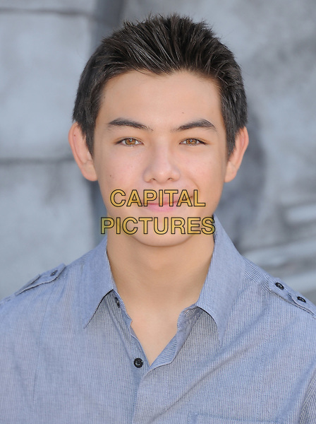 Ryan Potter.The L.A. Premiere of 'Puss in Boots' held at The Regency Village  Theatre in Westwood, California, USA..October 23rd, 2011 .headshot portrait blue shirt.CAP/RKE/DVS.©DVS/RockinExposures/Capital Pictures.