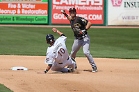 Quad Cities River Bandits shortstop Mott Hyde (3) turns a double play as Tucker Neuhaus (10) slides in during a game against the Wisconsin Timber Rattlers on May 2nd, 2015 at Fox Cities Stadium in Appleton, Wisconsin.  Quad Cities defeated Wisconsin 5-2.  (Brad Krause/Four Seam Images)