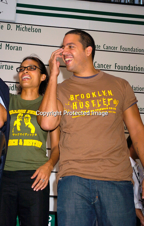 Rosario Dawson and David Blaine..at the Golf Digest Wall Street Invitational Putting Contest ..on September 22, 2004 at the New York Stock Exchange...The contestants putted for a million dollars for the charity of their choice.                                                       Photo by Robin Platzer, Twin Images
