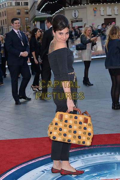 Gizzi Erskine .'Iron Man 3' UK film premiere, Odeon cinema, Leicester Square, London, England 18th April 2013..full length black off the shoulders belt gold bag red flats catsuit tartan plaid slippers loafers grey gray baggy casual sider over shoulder crochet back tattoo .CAP/PL  .©Phil Loftus/Capital Pictures.