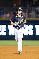 Matt Davidson (22) of the Charlotte Knights rounds the bases after hitting a home run against the Scranton/Wilkes-Barre RailRiders at BB&T Ballpark on July 17, 2014 in Charlotte, North Carolina.  The Knights defeated the RailRiders 9-5.  (Brian Westerholt/Four Seam Images)