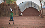 A girl carries water in the Yida refugee camp in South Sudan. Some 53,000 refugees from Sudan's Nuba Mountains live in the camp, with an equal number living in two nearby camps.