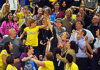 Fans reach for promotional merchandise during the ANZ Netball Championship match between the Central Pulse and Mainland Tactix at Te Rauparaha Arena, Wellington, New Zealand on Saturday, 11 May 2015. Photo: Dave Lintott / lintottphoto.co.nz